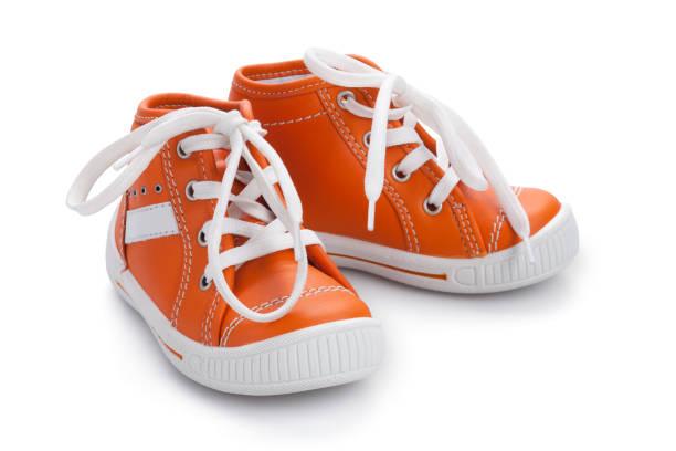 Orange baby shoe's - Isolated stock photo