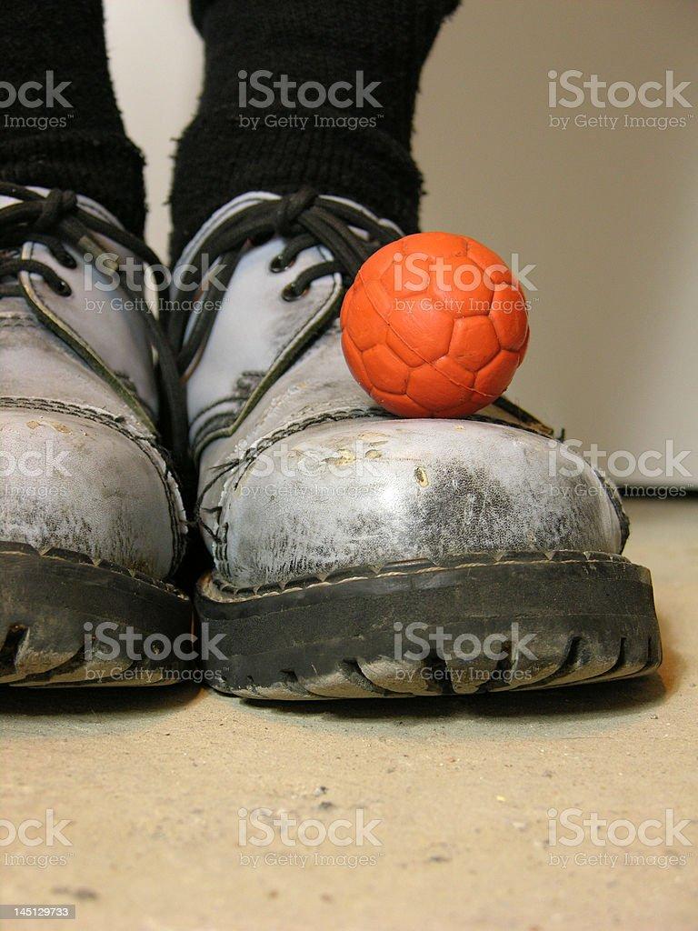 Orange ball on shoe royalty-free stock photo