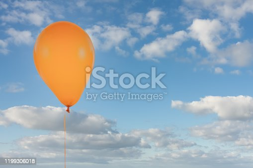 1141701990 istock photo Orange balloon isolated at blue sky with clouds 1199306018