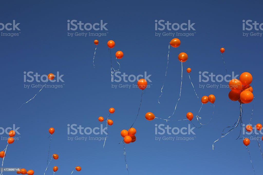 Orange Balloons Released on a Spring Day over Canada stock photo