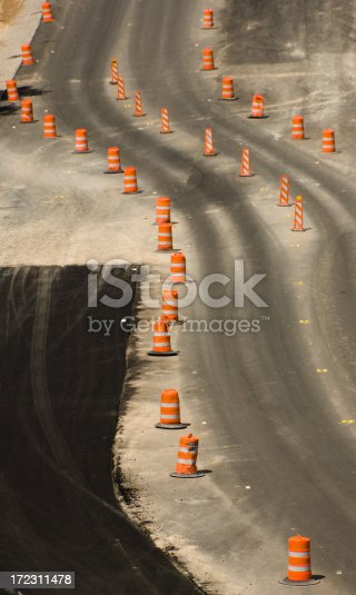 Orange barrels and temporary lanes form an abstract pattern of S-curves in this construction zone.
