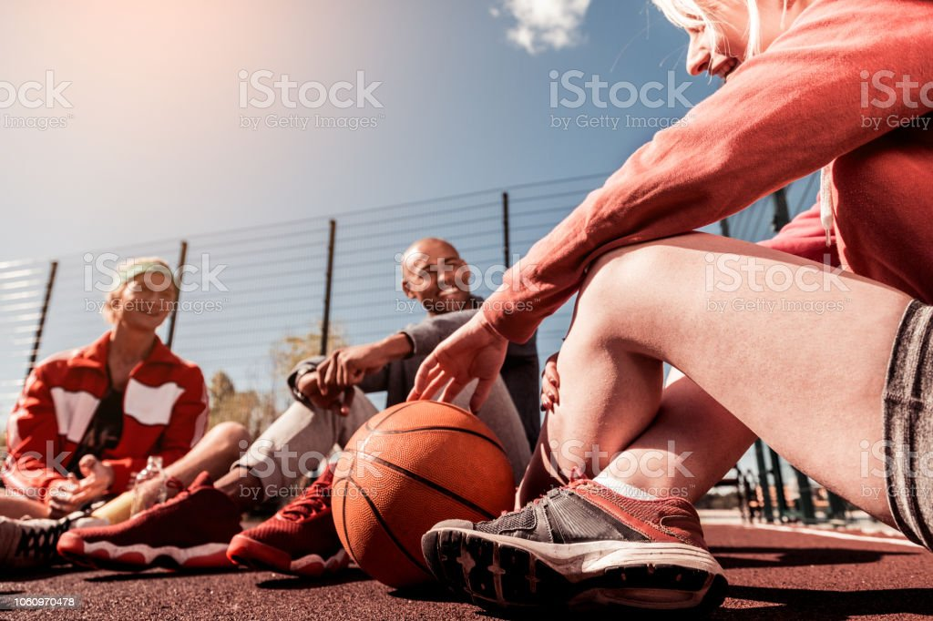 During the break. Basketball ball lying on the ground near positive...