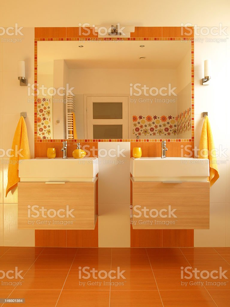 Orange bathroom with double sink royalty-free stock photo