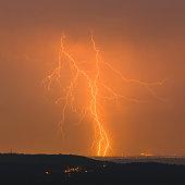 Night shot of a beautiful lightning strike in Italy