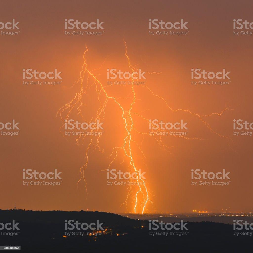 Orange beauty, lightning strike stock photo
