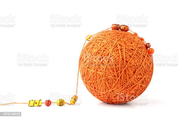 Orange big thread ball with jewelry beads isolated on white picture id1070748122?b=1&k=6&m=1070748122&s=612x612&h= 4vigfs8qmappat5et5pmxgubpegsx1bpdzohl3cquu=
