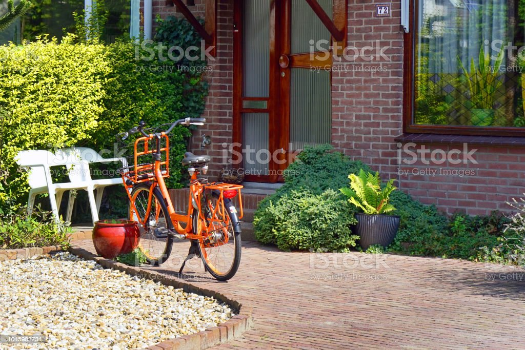 Orange bike in the courtyard of a private house stock photo