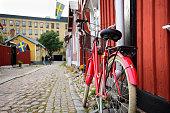 Orange bike parked in city Gavle, north of Stockholm