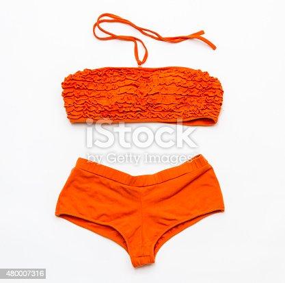 istock Orange bikini swimsuit  on white background. 480007316
