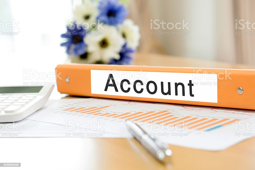 Orange  binder account on desk in the office with calculator stock photo