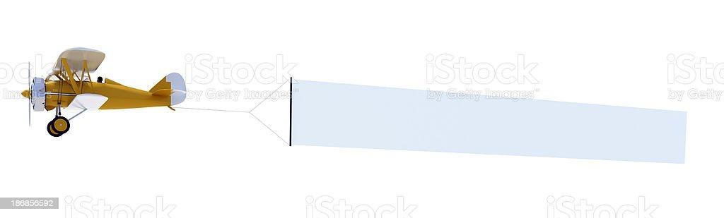 Orange biplane carrying a blank banner royalty-free stock photo