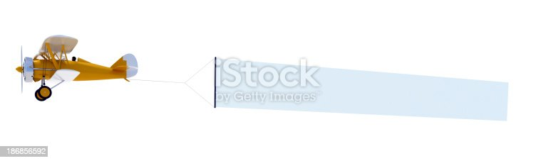 istock Orange biplane carrying a blank banner 186856592