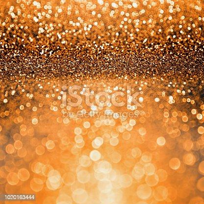 istock Orange Black Halloween Party or Thanksgiving Bash Sparkle Background 1020163444