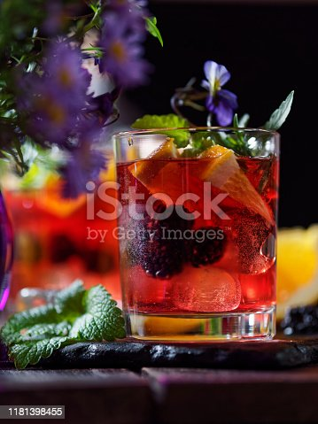 Orange blackberry punch with rum and sodas