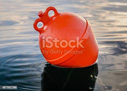 Orange boat buoy in the sea