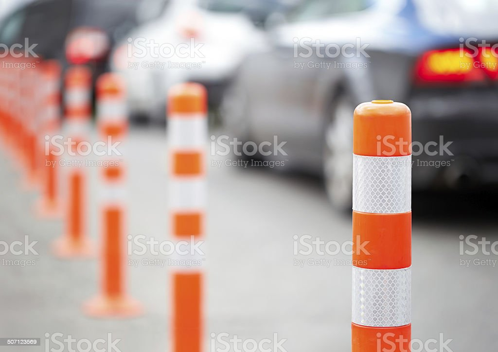 Orange bollard on the road. Traffic jam. stock photo