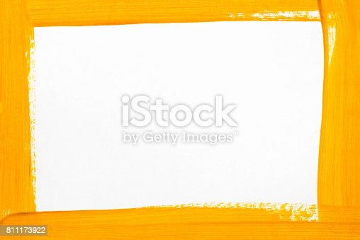 istock orange border painted on white paper 811173922