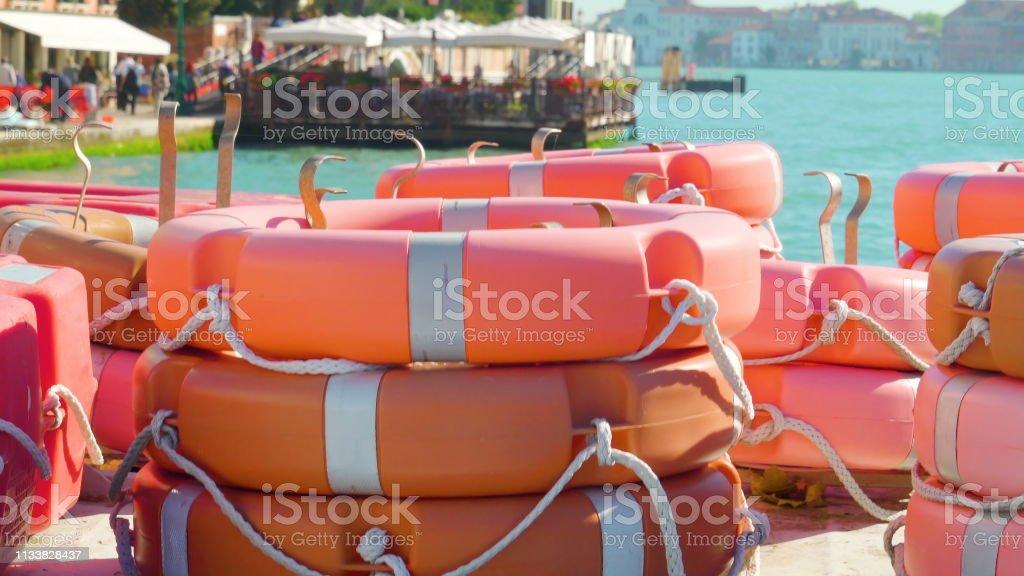 Orange bouys piled on the boat in Zattere port stock photo