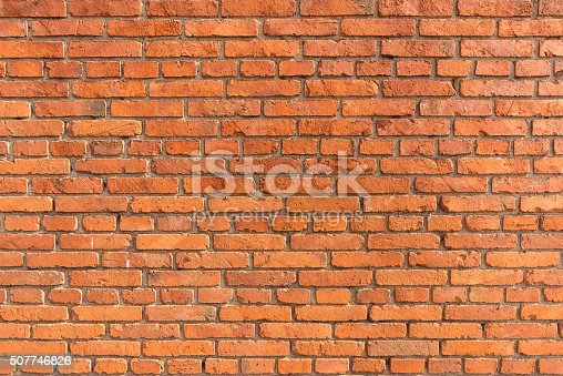 istock Orange brick wall background 507746826