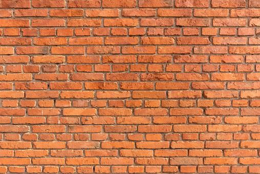 istock Orange brick wall background 507746826