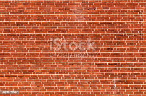 istock Orange brick wall texture background 489439618