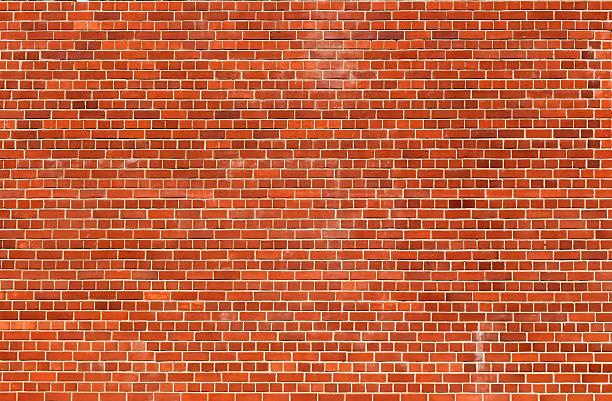 Orange brick wall texture background stock photo