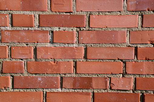 Photo of orange brick wall. May be used as texture or background.