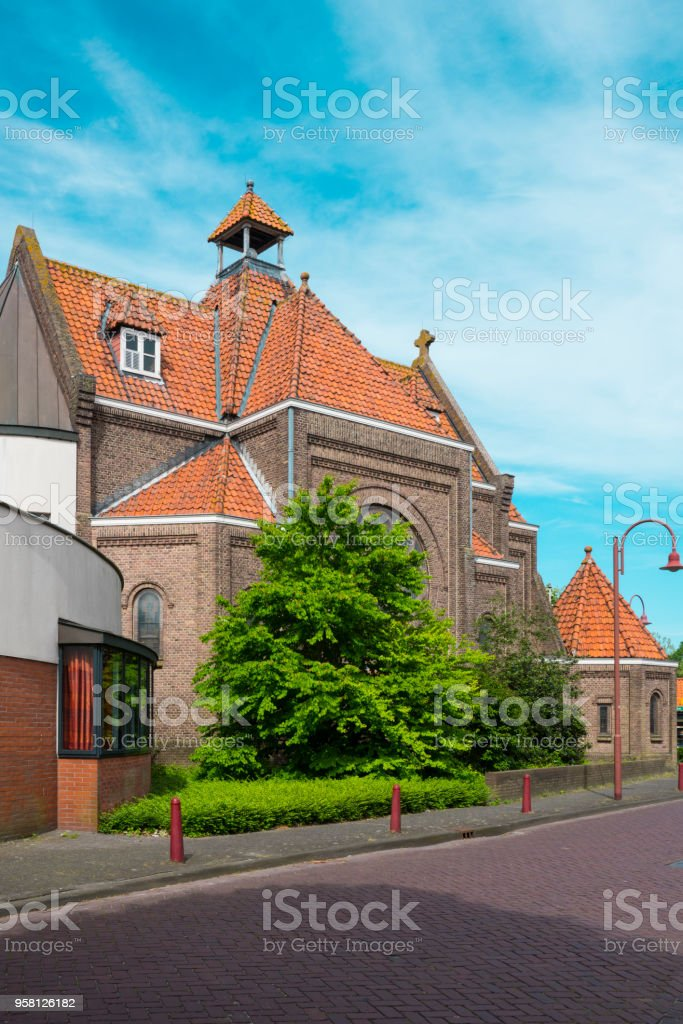 Orange building in Kerkstraat, Made, The Netherlands stock photo