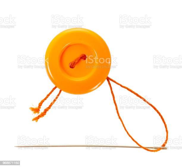 Orange button with thread and needle picture id968871150?b=1&k=6&m=968871150&s=612x612&h=an8zwjxhrruofo11uovye05chq0d3ynaaqveuesyjri=