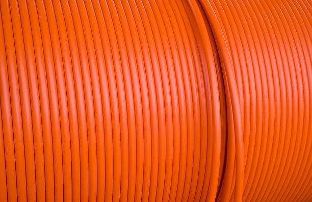 orange cable spool stock photo