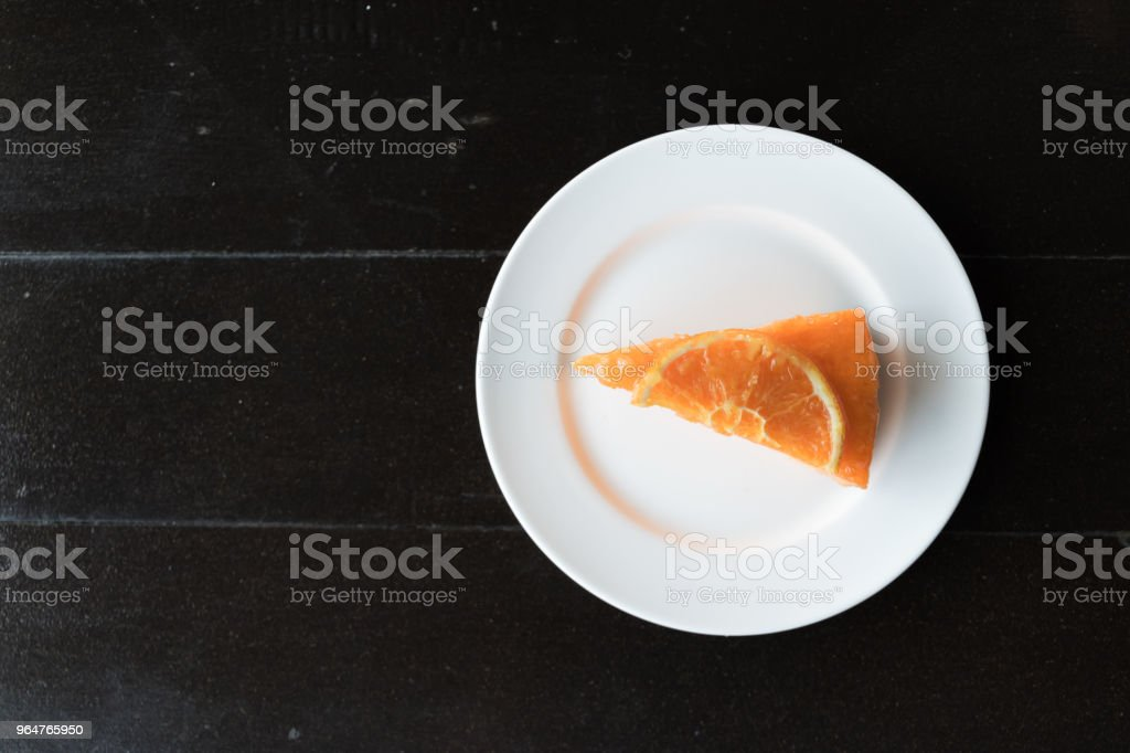 Orange cake on the wooden background royalty-free stock photo