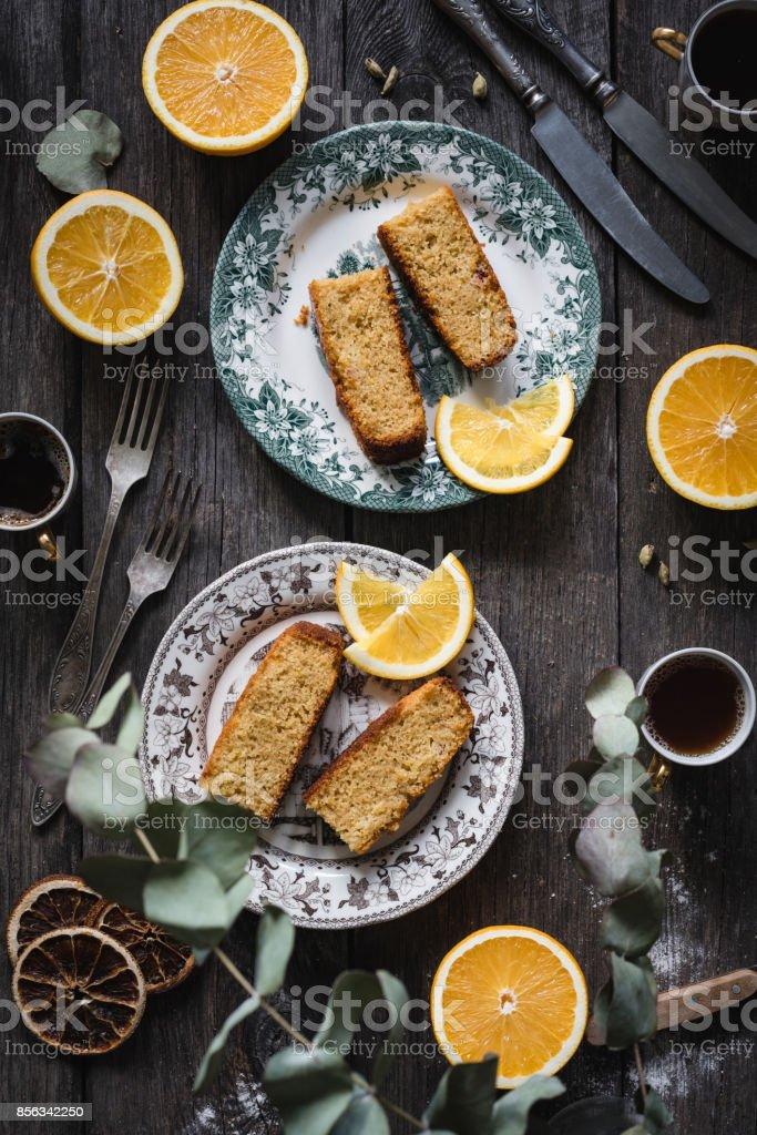 Orange cake sliced on vintage plates stock photo