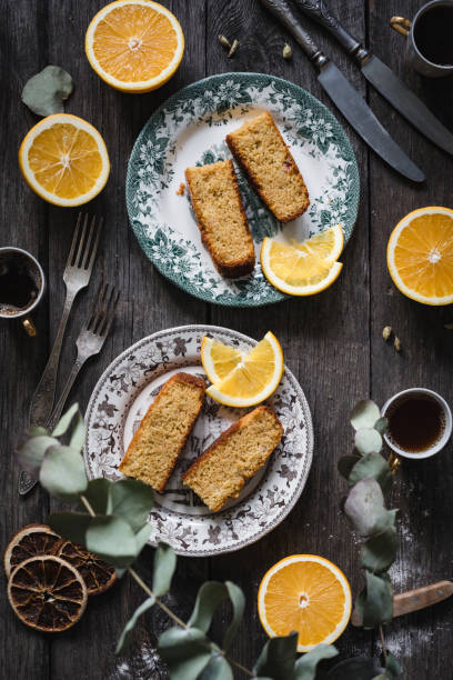 Orange cake sliced on vintage plates stock photo