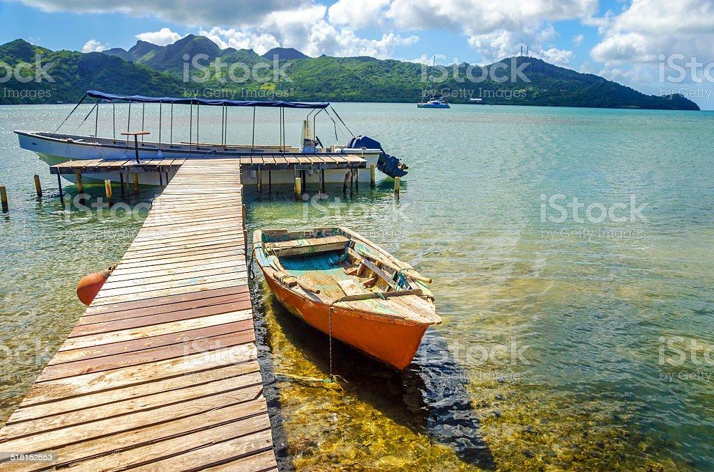 Orange Canoe and Pier stock photo