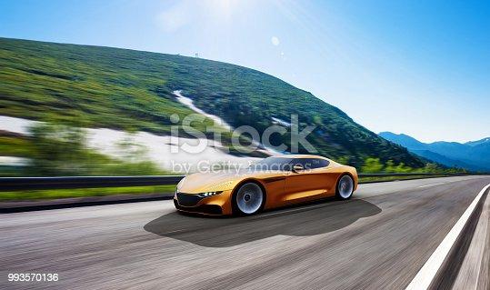 918555756 istock photo orange car driving on a mountain road 993570136