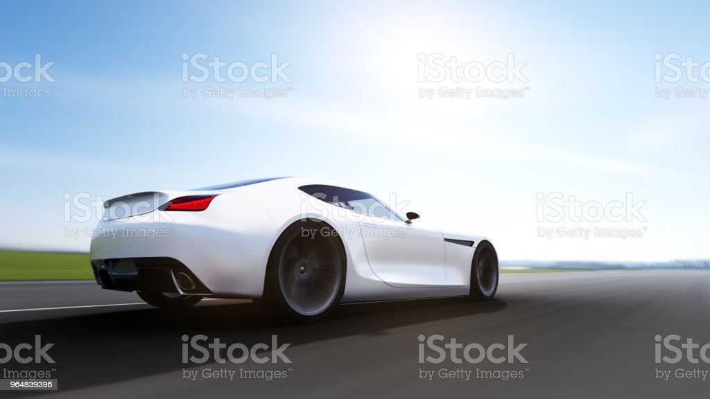 orange car driving on a road royalty-free stock photo