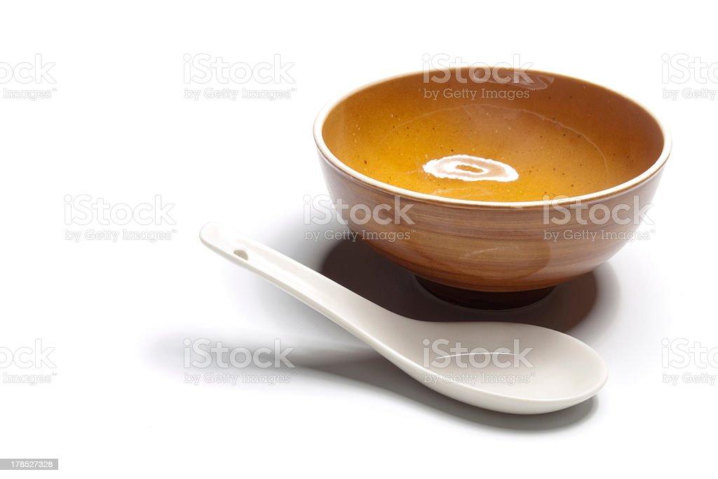 orange ceramic dish with spoon stock photo