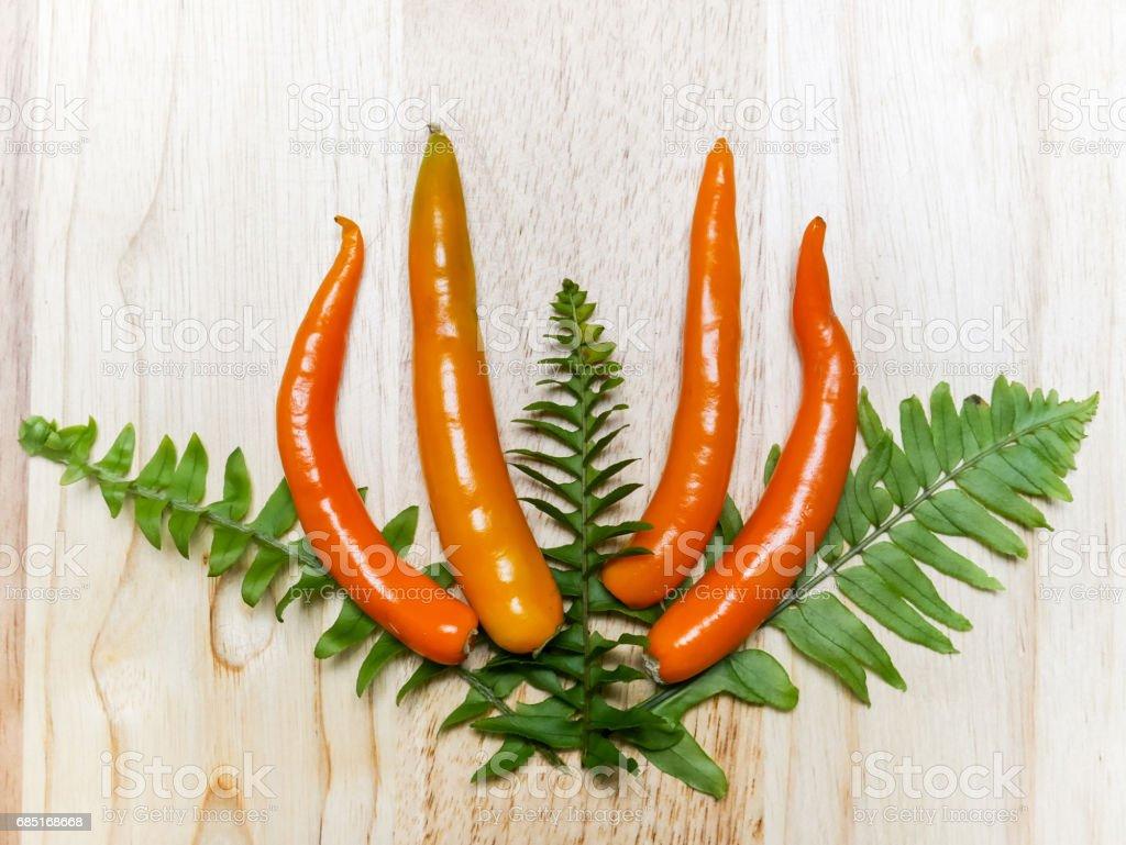Orange chili studio shot set on table royalty-free stock photo