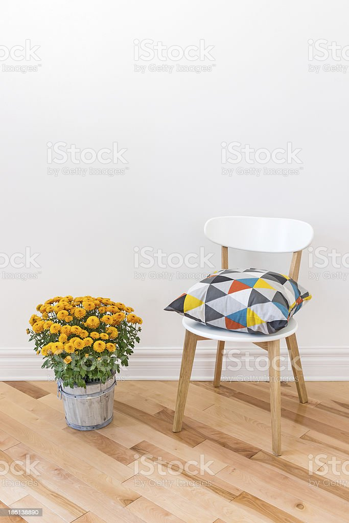 Orange chrysanthemums bright cushion on a chair stock photo