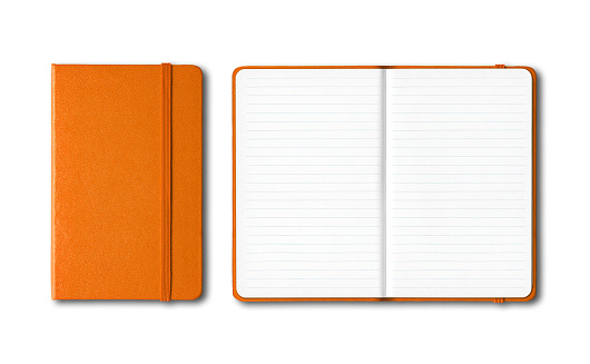 Orange closed and open lined notebooks isolated on white