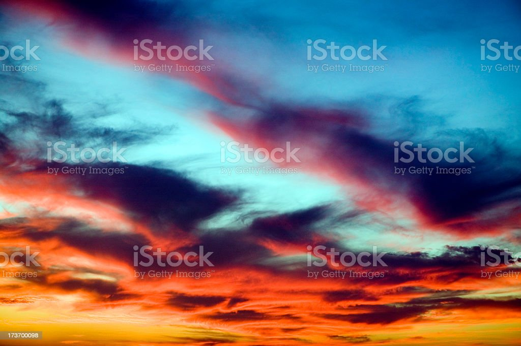 Orange clouds in a sunset against a blue sky royalty-free stock photo