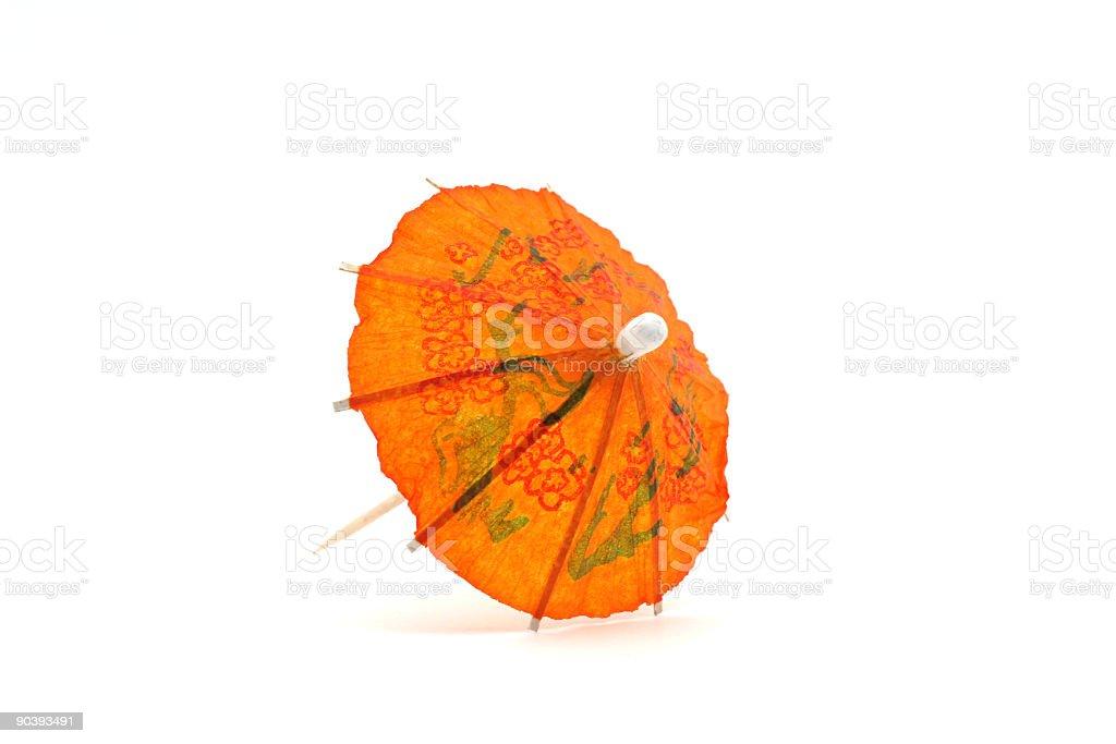 Orange cocktail umbrella, front view stock photo