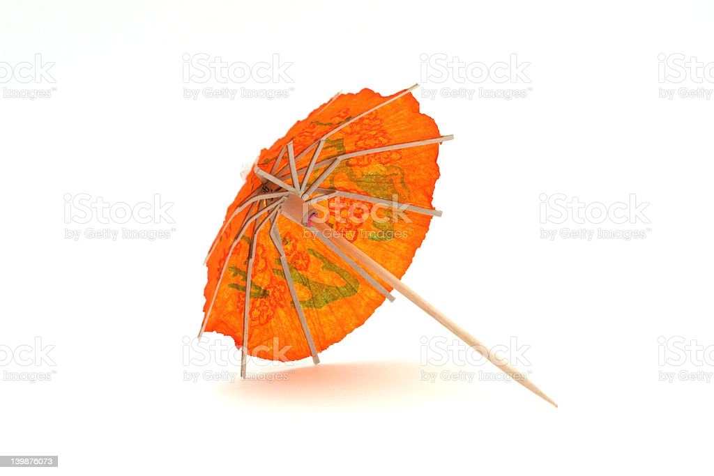 Orange cocktail umbrella, side view royalty-free stock photo