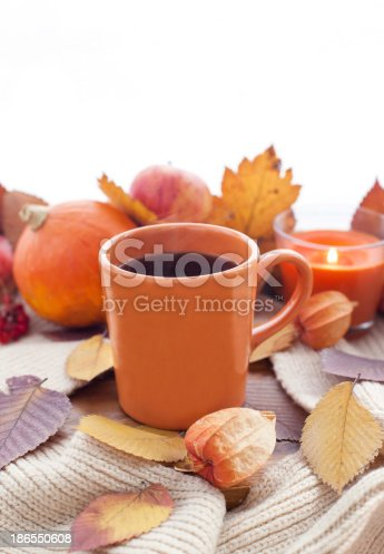 istock Orange coffee cup on the autumn fall leaves 186550608