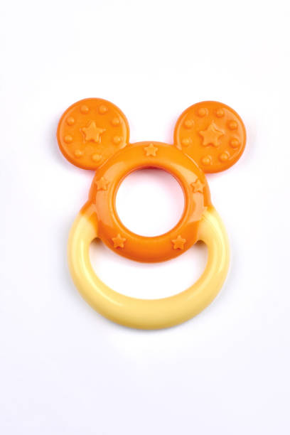 Orange color baby teether isolated picture id878245358?b=1&k=6&m=878245358&s=612x612&w=0&h=4dlihuqm1mmzfxhrlbw7n qsrt5hgzy2z4vru8w55my=