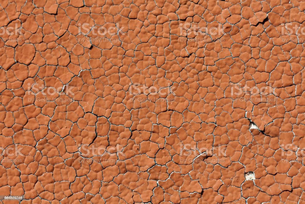 Orange color cracked plaster wall pattern royalty-free stock photo