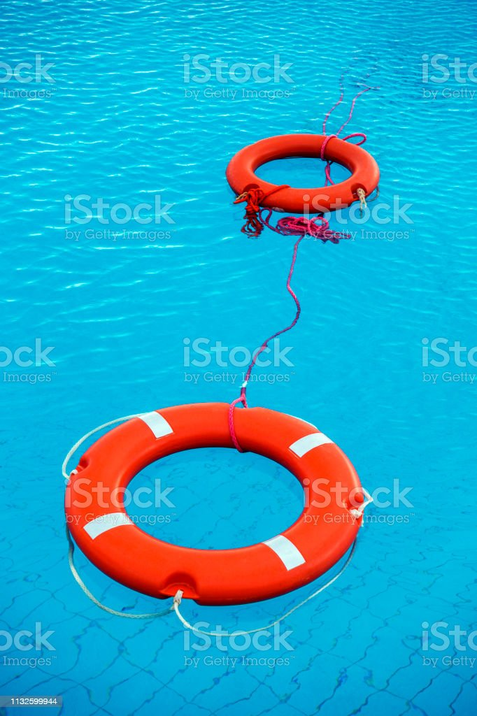 Orange Color Life Preservers Floating In Swimming Pool In Greece Stock  Photo - Download Image Now