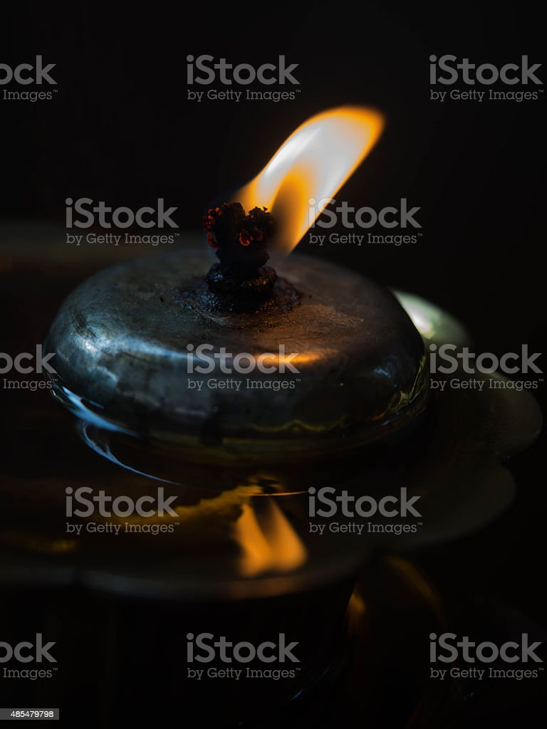 Orange color of Backlight from Oil lamp with reflection. stock photo