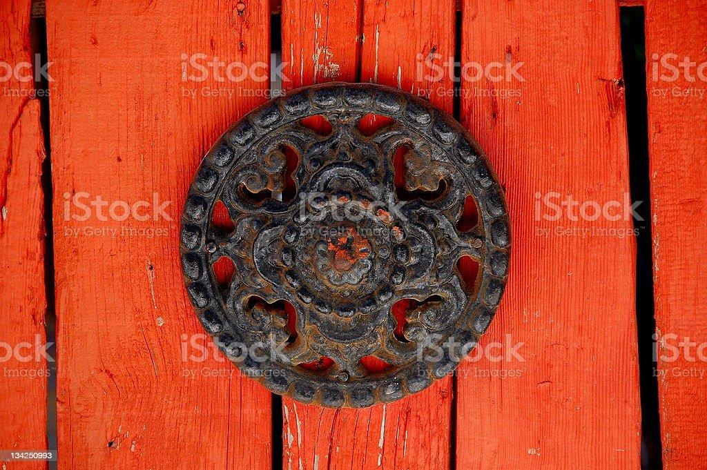 Orange color older wooden door iron detail. royalty-free stock photo