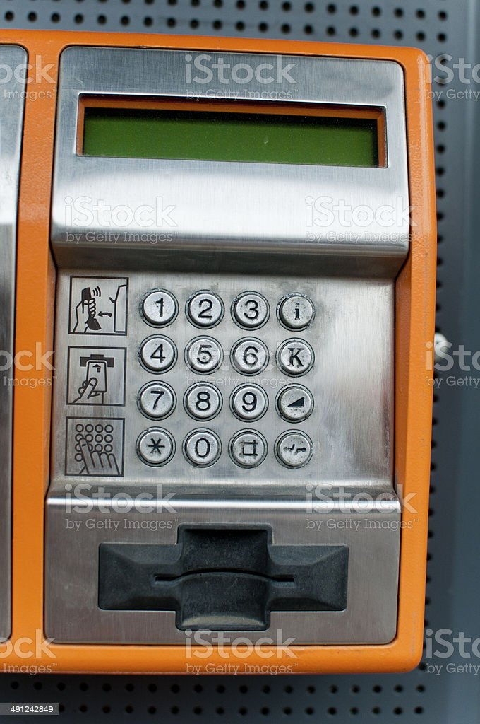 Orange Color Payphone royalty-free stock photo